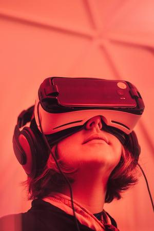 person wearing virtual reality gear - Photo by Samuel Zeller on Unsplash
